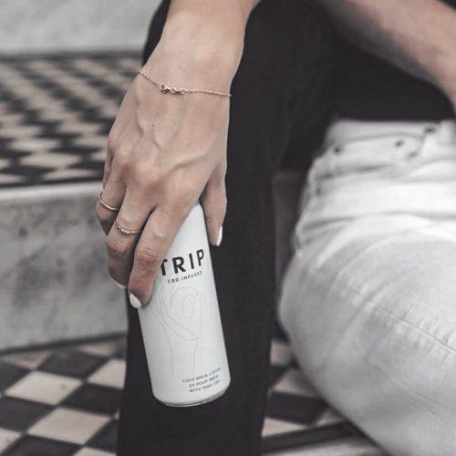 woman holding cbd drink